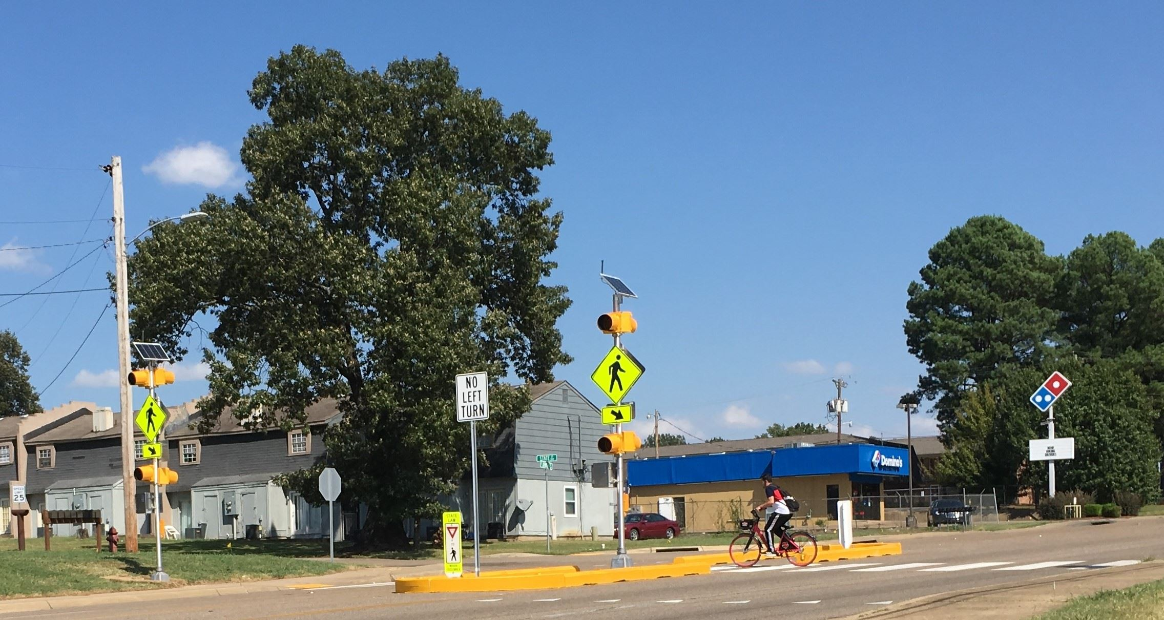 Cyclist at Highway 91 temporary pedestrian crossing